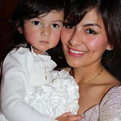 Sindy and her daughter Valentina who is wearing an original design by Sindy.