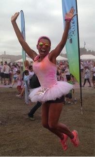 Coach Angela completing a marathon.