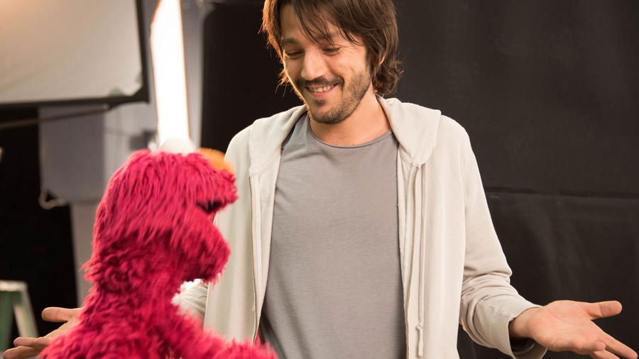 """Actor Diego Luna appears with muppet character Elmo on the new Spanish-language series """"Sesame Amigos,"""" debuting Aug. 1 on Univision. (Sesame Workshop / Univision / AP)"""