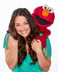 Actress Suki Lopez, with her friend Elmo. Sesame Workshop.