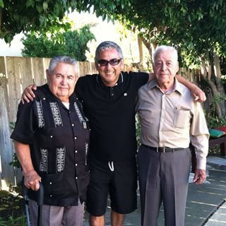 Frank pictured here with his father Regino Carbajal on the left and Godfather Vicente Perez on right.